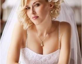 Красиві короткі весільні зачіски з фатою фото