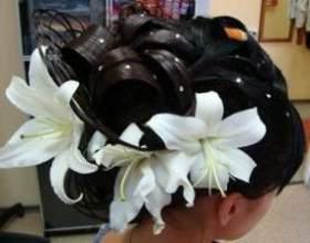 Весільні зачіски з квітами фото